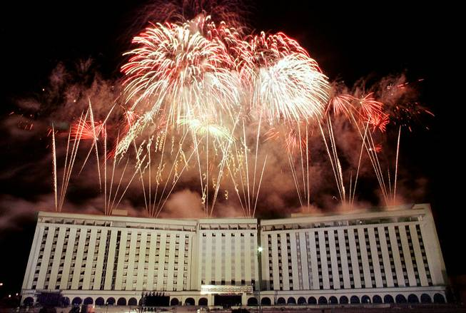 Fireworks erupt from the roof of the Hacienda hotel-casino minutes before it is imploded on New Year's Eve Dec. 31, 1996.
