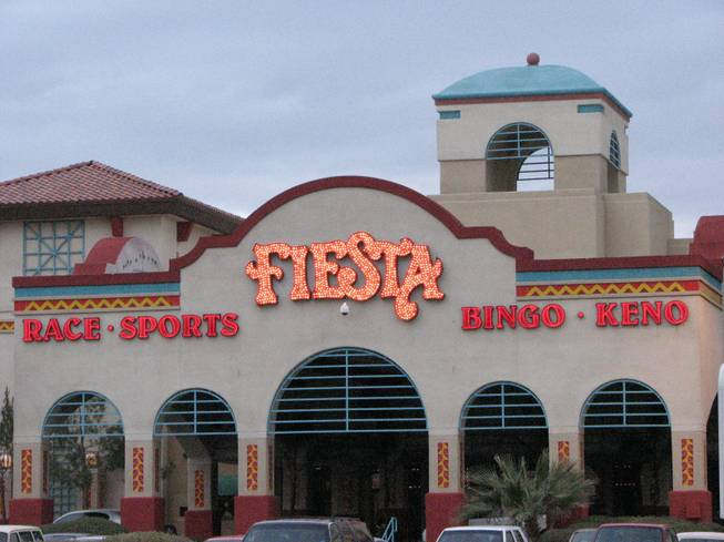 The sign of the Fiesta Rancho lights up as dusk falls over the hotel-casino. The Fiesta Rancho was the first ever Fiesta casino. It was owned and operated by the Maloof family until Station Casinos Inc. bought the property in January 2001 and franchised the Fiesta name.