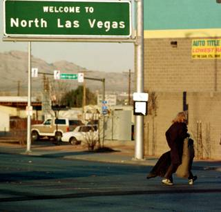 A homeless man crosses Las Vegas Boulevard into North Las Vegas on Feb. 15, 1999, showing that it's not all glitz and glamour in &#8220Sin City.&#8221