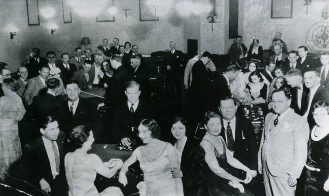 Tony Cornero sits far left at The Meadows Casino. The owner of the Stardust Hotel and Casino, dropped dead on July 31, 1955 while shooting craps at the Desert Inn.