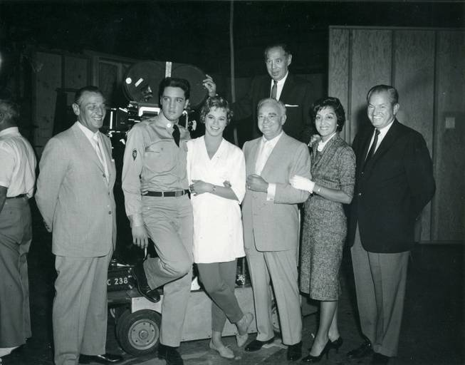 "Left to right: Moe Dalitz, Elvis Presley, Juliet Prowse, Wilbur and Tom Clark, Cecil Simmons. Joe Franks, pose on the set of ""G.I. Blues"" in Hollywood in 1960."
