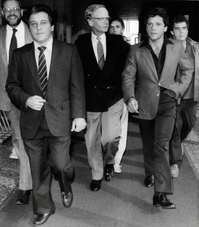 Mobster Anthony Spilotro, left, and his brother, Michael, leave the federal building in Chicago after a bond hearing in 1986. In June of that year the bodies of the Spilotro brothers were found buried in an Indiana cornfield. Sand inside of the lungs of the bodies lead investigators to conclude that the pair had been buried alive.