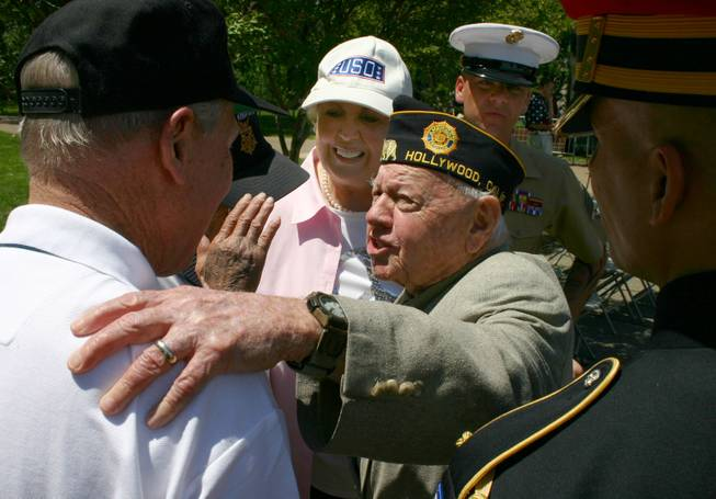 In this photo provided by Lincoln Highway National Museum, World War II Veteran Mickey Rooney, 87, talks with Medal of Honor recipient Captain Thomas J. Hudner, USN while his wife Jan and others looks on during the National Memorial Day Celebration in Washington D.C. Monday May 26, 2008.