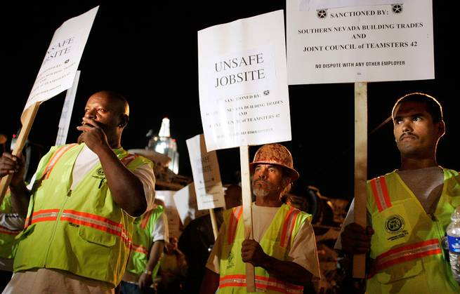Standing outside CityCenter's contruction entrance on Frank Sinatra Drive and Rue de Monte Carlo, Laborers Local 872 members Eric Johnson, Javier Flores and Edgar Saldana participate in a picket of the project where they work.