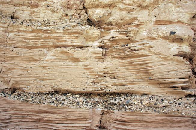 "Stratification is seen in the sides of ""Double Negative,"" which was dug, drilled and dynamited by Bryant Robison and two other men under Heizer's direction."