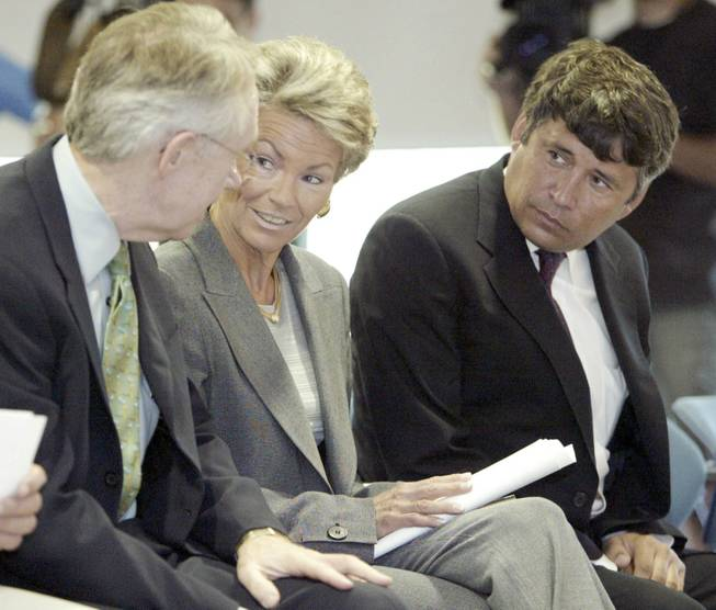 When Pat Mulroy, center, got involved in the land act, she demanded that it contain a clause diverting 10 percent from land sales to her Southern Nevada Water Authority. Mulroy is seen with Reid, left, and Interior official Bennett Raley in 2004.
