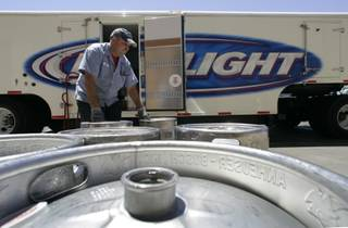 Bob Roik, a Nevada Beverage draft sales rep, picks up empty kegs of beer at Cashman Field.