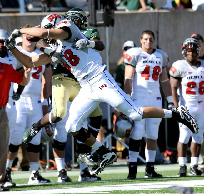 UNLV tight end Anthony Vidal (88) attempts to catch a pass as Colorado State running back Leonard Mason (2) grabs him in coverage during Saturday's game at Hughes Stadium in Fort Collins, Colo.