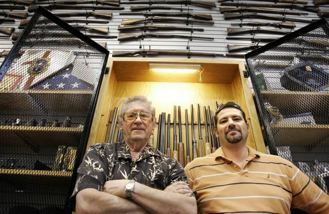 George Bramlett, left, owner of Bargain Pawn in North Las Vegas, with his son, general manager David Bramlett, says people who've never pawned anything before are now desperate for cash.