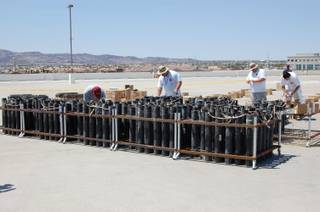Pyrotechnicians of Grucci's of New York prepare for Friday's Fourth of July firework display atop the Sunset Station Casino in Henderson. The show at Sunset is one of five Station Casino shows done by Grucci's this Forth of July.