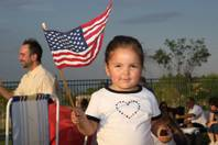 While enjoying a summertime picnic, 2-year-old Julia Gomez waves her American flag during the Las Vegas Philharmonic's 10th Anniversary Star Spangled Spectacular Fourth of July celebration at Hills Park in Summerlin.