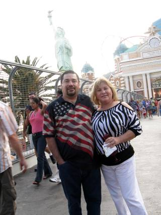 Roger and Maribel Solorzano smile in front of New York's Statue of Liberty. The Solorzanos are from Palm Springs, Calif.