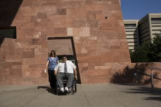 Kathy, left, and Tom Urbanski arrive at the Regional Justice Center for Tom to testify in a grand jury investigation into the 2007 Minxx strip club shooting that left him paralyzed from the waist down.