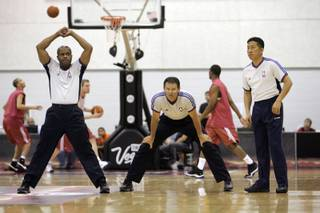 Officials stretch out as they prepare for a NBA Summer League game  between New York Knicks and Cleveland Cavaliers at the Cox Pavilion in Las Vegas on Monday July 14.