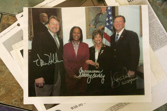 Anishya Sanders, second from left,  poses in this signed photo with, from left, Reps. Dean Heller, Shelley Berkley and Jon Porter, all of Nevada.