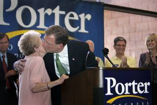 Congressman Jon Porter, R-Nev., gives a kiss to his mother Bette as he kicks off his re-election campaign at the Nevada State College in Henderson on Wednesday.