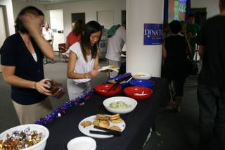Volunteers at the Dina Titus party take a break for some food at the snack table. Titus is Democratic candidate for the 3rd Congressional District.
