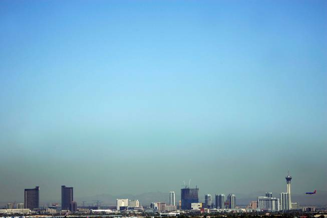 When we left Las Vegas on Tuesday, I couldn't help but notice the thick layer of haze/smog/dust that hung above the valley in a menacing way. We're headed to Phoenix. My thought is, I wonder if they have the same problem? Another city with big growth and big traffic. <em> - Leila Navidi</em>.