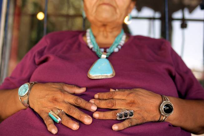 "Of all the people selling handmade jewelry and crafts in old town Albuquerque, Juanita Peters was one of the only ones wearing a lot of jewelry. She sports a few pieces made by her sister's husband, and one made by the artist in the space next to her. ""I've been making jewelry since I was 9 years old,"" said Peters, of Santo Domingo Pueblo. She's been selling jewelry at the Historic Old Town Portal for about seven years. The Portal is run by the city of Albuquerque, and there are 15 spaces for vendors. With about 50 permit holders there is a weekly lottery for spaces. - Leila Navidi"