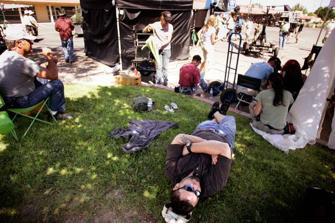 """This is the best job in the world,"" Drew Dixon says as he lays back in the grass on the set of the television show ""Easy Money,"" filming in Albuquerque. Dixon is a stand-in for actor Jay R. Ferguson, who plays Cooper Buffkin in the series. A stand-in is someone who literally stands for the actor during the composition and lighting setup of the shots. There is a lot of ""hurry up and wait"" associated with this job, hence the down time. Stand-ins also get paid more than extras, hence Dixon's job satisfaction. - Leila Navidi"