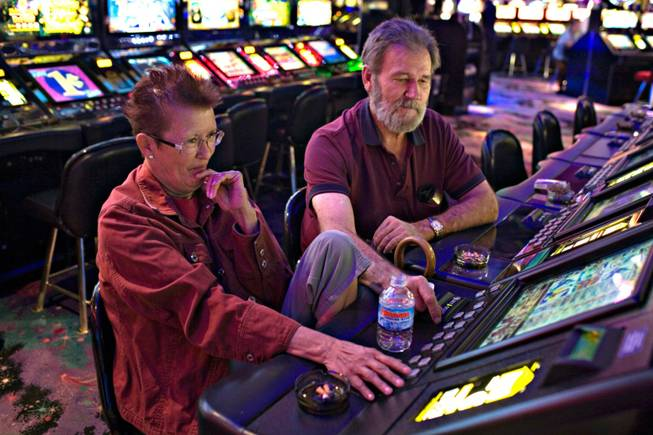 "Longtime Henderson residents Lilly Santos, left, and DeVan Tippetts play the penny slots Thursday at the Rainbow. John Awalt, the casino's general manager, says, ""Our restaurant gets people in the door. Service is prompt and the portions aren't skimpy.zz'"