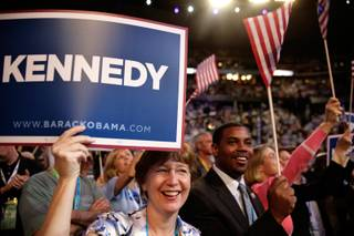 State Assembly Speaker Barbara Buckley, from left, and State Senator Steven Horsford cheer for Caroline Kennedy as she speaks inside the Pepsi Center during the first day of the Democratic National Convention in Denver.