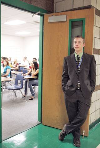 Josh Adams waits at his classroom door for straggling students on the first day of classes at Green Valley High School on Monday. Adams, a new math teacher, recently moved to Las Vegas from Kansas.