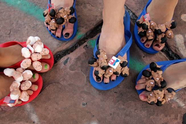 Lesson of the day: look down. As a photographer, I'm always looking left, right, forward, backward and even up. Sometimes I forget to look down. I did when passing by this group of cheerful flip-floppers Tuesday. They were selling them (of course), and paused for a moment to pose together for my first flip-flop portrait. -- Leila Navidi