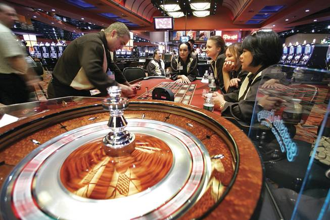 Roulette dealer John Furry, left, practices Tuesday at the Eastside Cannery for the $250 million, 307-room casino's opening tonight on Boulder Highway.