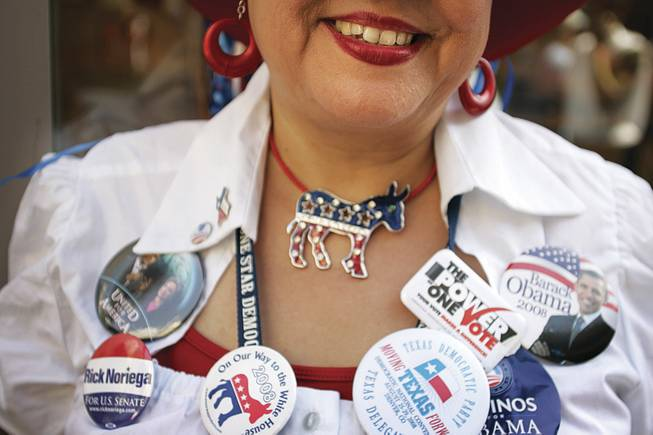 Conventiongoer Lucy Rubio of Corpus Christi, Texas, is adorned with political buttons and bling galore.