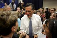 Mitt Romney visits with voters after he speaking to a crowded room of supporters at the Henderson Convention Center on Wednesday, Aug. 27, 2008.