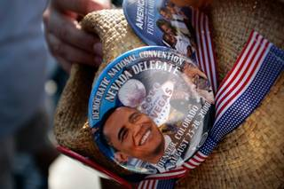 A Nevada delegate holds his hat at Mile HIgh Stadium in downtown Denver Thursday before Barack Obama's acceptance speech.