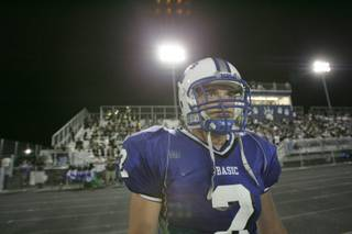 Basic's Anthony Ireland looks on from the sidelines during the season opener against Boulder City Friday.