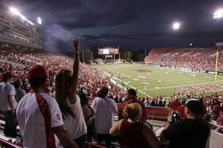 A UNLV fan celebrates Saturday as UNLV takes an early lead with a touchdown in the first quarter at Sam Boyd Stadium.