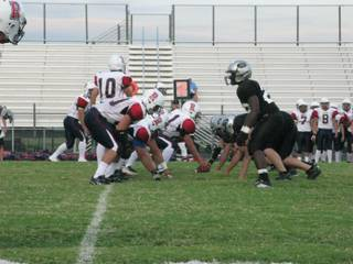 The Palo Verde defense lines up against Reno High School during Reno's first possession of the game. The Panthers' defense kept Reno from scoring a single point.