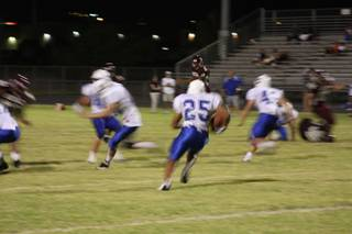 Junior running back Stephen Nixon carries the ball during Friday's loss to Dixie High School.