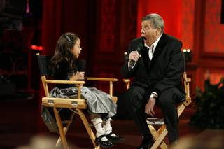 Entertainer Jerry Lewis jokes with Abbey Umali, 9, the 2008 MDA national goodwill ambassador, during the 43rd annual MDA Labor Day telethon at the South Point hotel-casino on Monday.