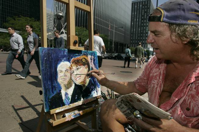 "Patrick Ginter paints a portrait of the presumptive Republican nominee for president, John McCain, and his running mate, Sarah Palin, on Monday outside the Republican National Convention in St. Paul. ""It's political season so you gotta paint political,"" Ginter said."