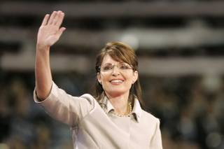 John McCain's vice presidential pick Sarah Palin waves as she takes the stage at the Republican National Convention on Wednesday night.