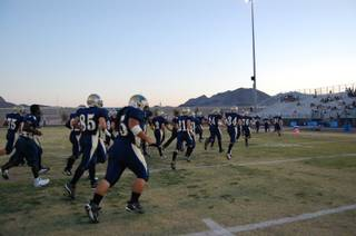 The Foothill High School Falcons enter the field, ready to battle the Cimarron-Memorial High School Spartans on Friday night.