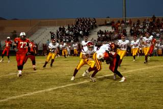 Del Sol's Tayiib Dauda takes down Chaparral's Pierre Jones during the first quarter of Friday's game.