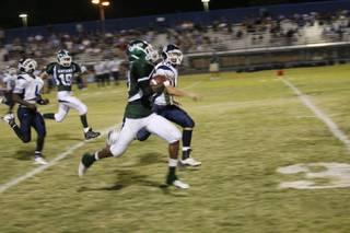 Green Valley wide receiver Derrick Stevens runs for a touchdown during a home game against Centennial on Friday night.