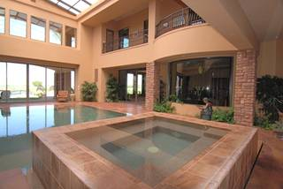 A view of the indoor pool and hot tub at Fred Segal's house.