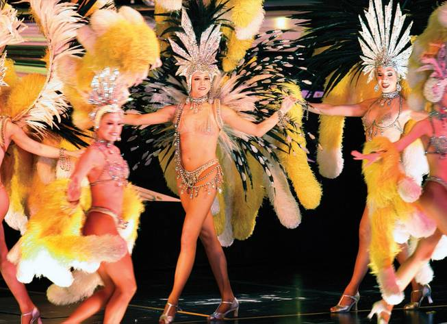"Katie Currow, center, during a performance of ""Donn Arden's Jubilee!,"" one of two surviving Las Vegas showgirl extravaganzas, at Bally's on Aug. 17. is flanked by Amelia Bruff, left, and Jenny Lee."