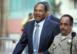 O.J. Simpson arrives at the Clark County Regional Justice Center on the third day of jury selection for his trial Sept. 10, 2008, in Las Vegas, Nev. Simpson is facing charges which include burglary, robbery and assault following an alleged robbery at the Palace Station Hotel & Casino in September, 2007.