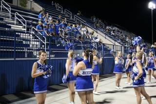 Dixie High School cheerleaders offer some school spirit in front of the group that made the trip from Utah. Bishop Gorman defeated Dixie, 20-14, in overtime.