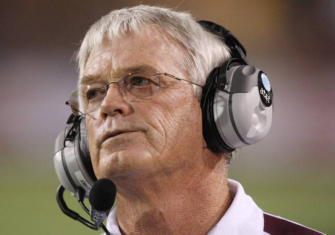 Arizona State head coach Dennis Erickson looks up at the scoreboard in a game against UNLV in 2008.
