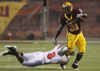 UNLV defensive back Daryl Forte (8) tackles Arizona State running back Dimitri Nance (31) in the first quarter.