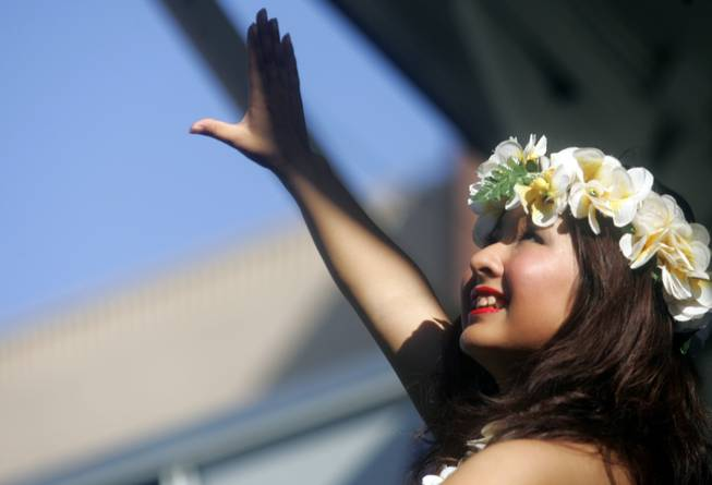 Akira Nonaka dances the hula during the 18th annual Prince Jonah Kuhio Ho'olaule'a Pacific Islands Festival at the Henderson Events Plaza. Nonaka is a member of the Hula Huio Hihao dance group.