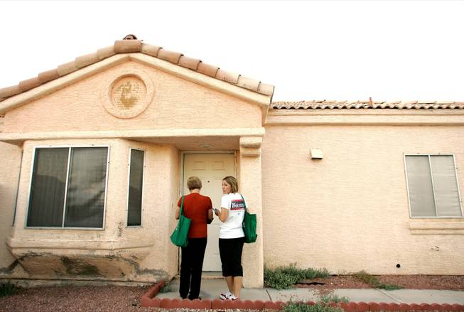 Breeden, left, and daughter Jennifer Breeden go door to door in Breeden's September 2008 effort to unseat GOP Sen. Joe Heck. The Democrat has yet to publicly share her ideas for solving the state's problems.
